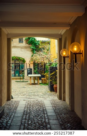 Arch with lamps to the yard - stock photo