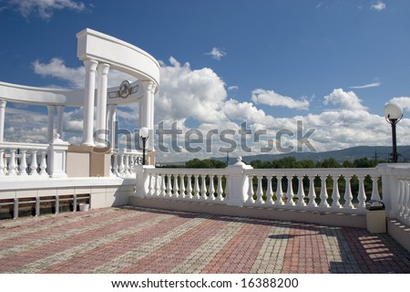 Arch with white columns on a background of the dark blue sky. - stock photo