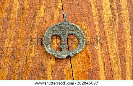 archaeological find. old copper earring. Chernyakhov culture  2nd and 5th centuries AD - stock photo