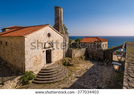 Archaeological museum in historical buildings of Ulcinj old town. Adriatic sea at a background. Montenegro. - stock photo