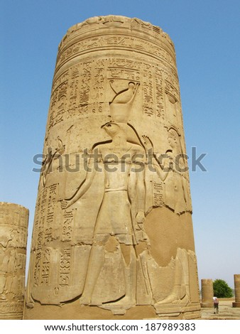 Archaeological site of Kom Ombo, Egypt: column with Horus god relief - stock photo