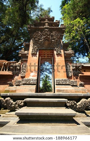 Arched entrance sculpture Pura Tirta Umple Temple at Bali Island Indonesia - stock photo