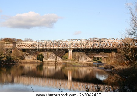 Arched Railway Bridge of England's West Coast Main Railway Line crosses the River Ribble in Preston, Lancashire. - stock photo