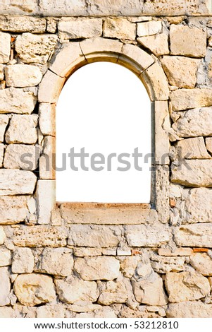 Arched window in a stone wall - stock photo