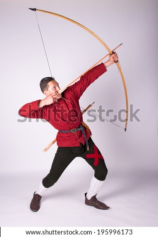 Archer in a historical costume with bow - stock photo