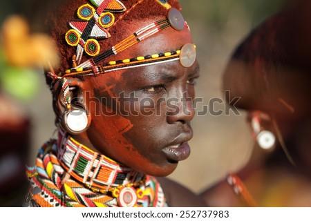 ARCHERS POST - KENYA - JANUARY 14, 2015: Unidentified Samburu warrior attending a wedding ceremony on January 14, 2015 in Archers Post, Kenya.  - stock photo