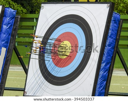 Archery arrow and target - stock photo