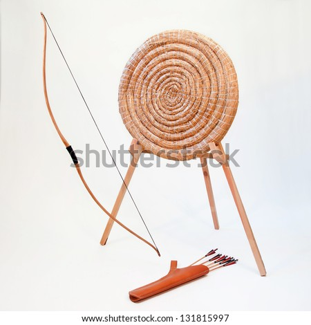 Archery equipment - bow, quiver with arrows and target - stock photo
