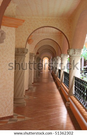 Arches of beach front hotel - stock photo