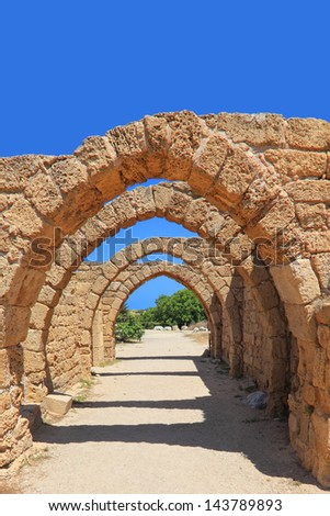 Arches of the old crusaders town - stock photo