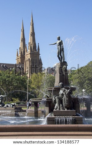 Archibald Fountain and St Mary's Cathedral on a sunny day taken from Hyde Park Sydney, Australia. Image by Kevin Hellon - stock photo