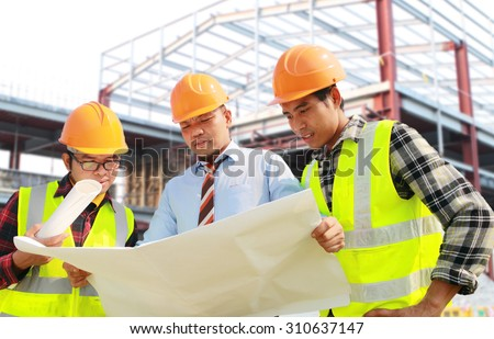 Architect and foreman construction worker discussion a plan, looking blueprint on location site - stock photo