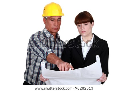 Architect and foreman discussing plans - stock photo