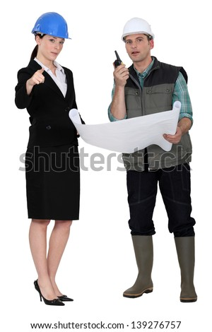 Architect and foreman making decisions - stock photo