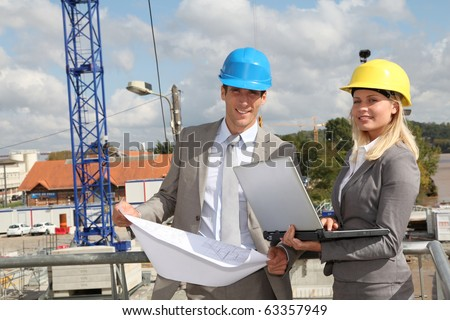 Architect and supervisor checking site under construction - stock photo
