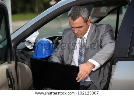 Architect arriving at construction site - stock photo