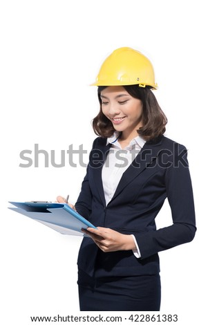 Architect business woman standing against white. Young smiling woman. Building helmet. - stock photo