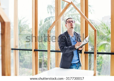 architect checking the quality of house model - stock photo