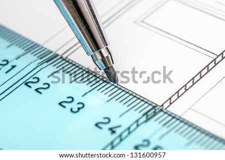 Architect Drawing A House Plan With The Help Of His Tools Pencil and Ruler - stock photo