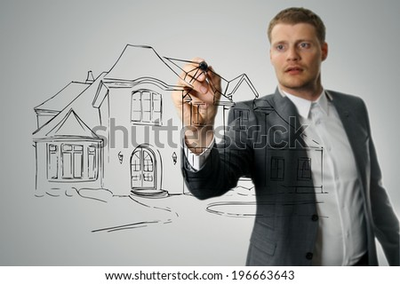 architect drawing house development sketch - stock photo