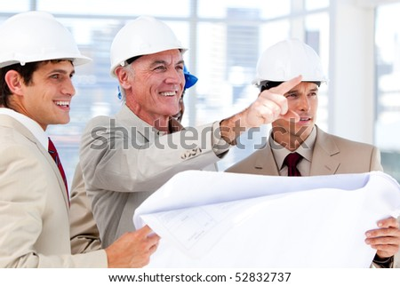 Architect explaining the project to the team on the field - stock photo