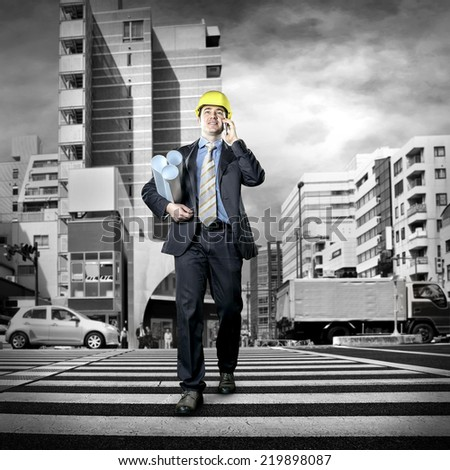 Architect in protective helmet stay on the crossroad - stock photo
