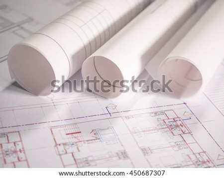 Architect plan rolls on the table with Selective focus - stock photo