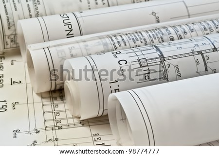 Architect rolls and plans - stock photo