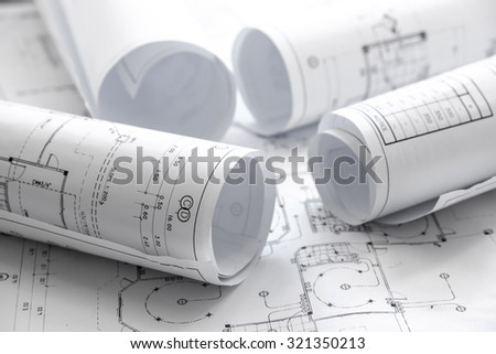 Architect rolls and plans.architectural plan,technical project drawing - stock photo