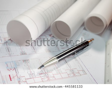 Architect rolls, plans and pen (Selective focus) - stock photo