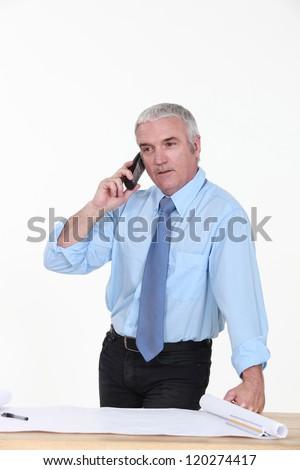 Architect taking a telephone call - stock photo