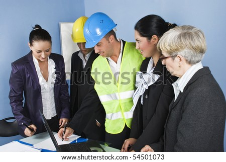 Architect team in office having a discussion at meeting and smiling together,an engineer man showing or design something on a paper - stock photo
