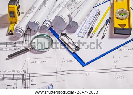 architect tools on white blueprint construction concept  - stock photo