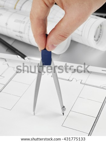 Architect with drawing compass - stock photo