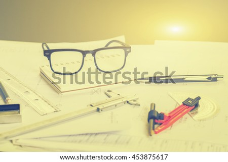 Architect working,repair, building and home concept,making changes to blueprint,for designer drawing house plan for reconstruction. Architectural project ,selective focus,vintage color - stock photo