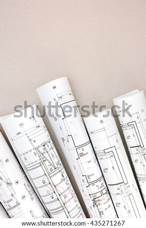 architect workspace with rolls of blueprints and technical drawings - stock photo