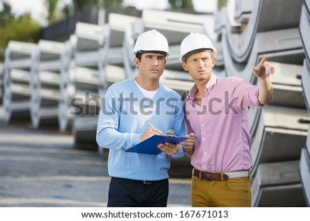 Architects inspecting stock at site - stock photo