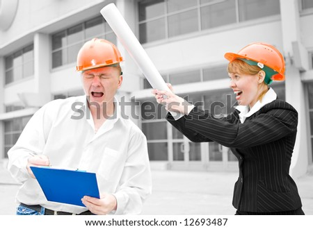 architects man and woman beat roll on head chief - stock photo