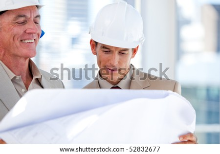 Architects partners looking at the building in the company - stock photo