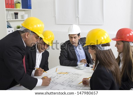 Architects working in office on construction project - stock photo