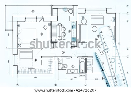 architects workspace with house blueprint, pencil and ruler  - stock photo