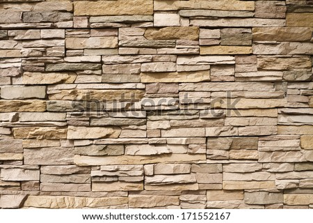 Architectural background of contemporary stacked stone wall - stock photo