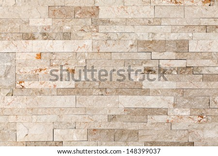 Architectural background texture. Wall made of marble blocks - stock photo