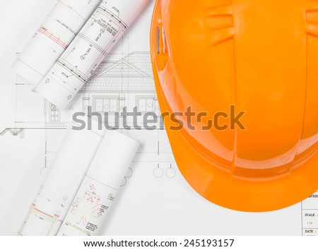 Architectural blueprint of office building with a pencils and Helmet Safety - stock photo