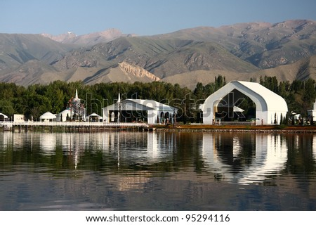 Architectural complex on the bank of mountain lake.Kyrgyzstan. Lake  Issyk-kul. - stock photo