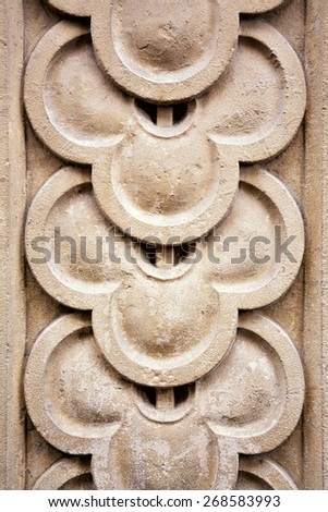 Architectural detail. Carved overlap pattern, ancient stonemasonry. - stock photo
