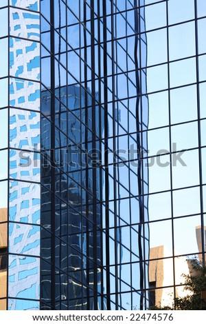 Architectural Detail Mirroring Windows - stock photo