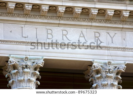 Architectural detail of a university library building, showing the letters LIBRARY chiseled into its limestone. - stock photo