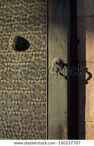Architectural detail of an old Turkish door. Fatih Mosque in Istanbul, Turkey. - stock photo