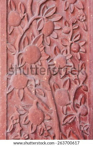 Architectural detail of carved flowers at the palace of Fatehpur Sikri, ancient city founded by Mughal emperor Akbar, famous Indian Mughal architecture  in Agra, Uttar Pradesh, India - stock photo